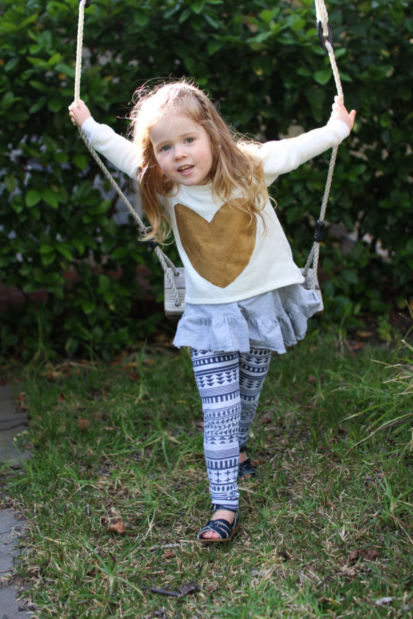 A Mini Briar sweater for Birdie made from cream polar fleece and with gold hearts on the front and elbows // Megan Nielsen Design Diary