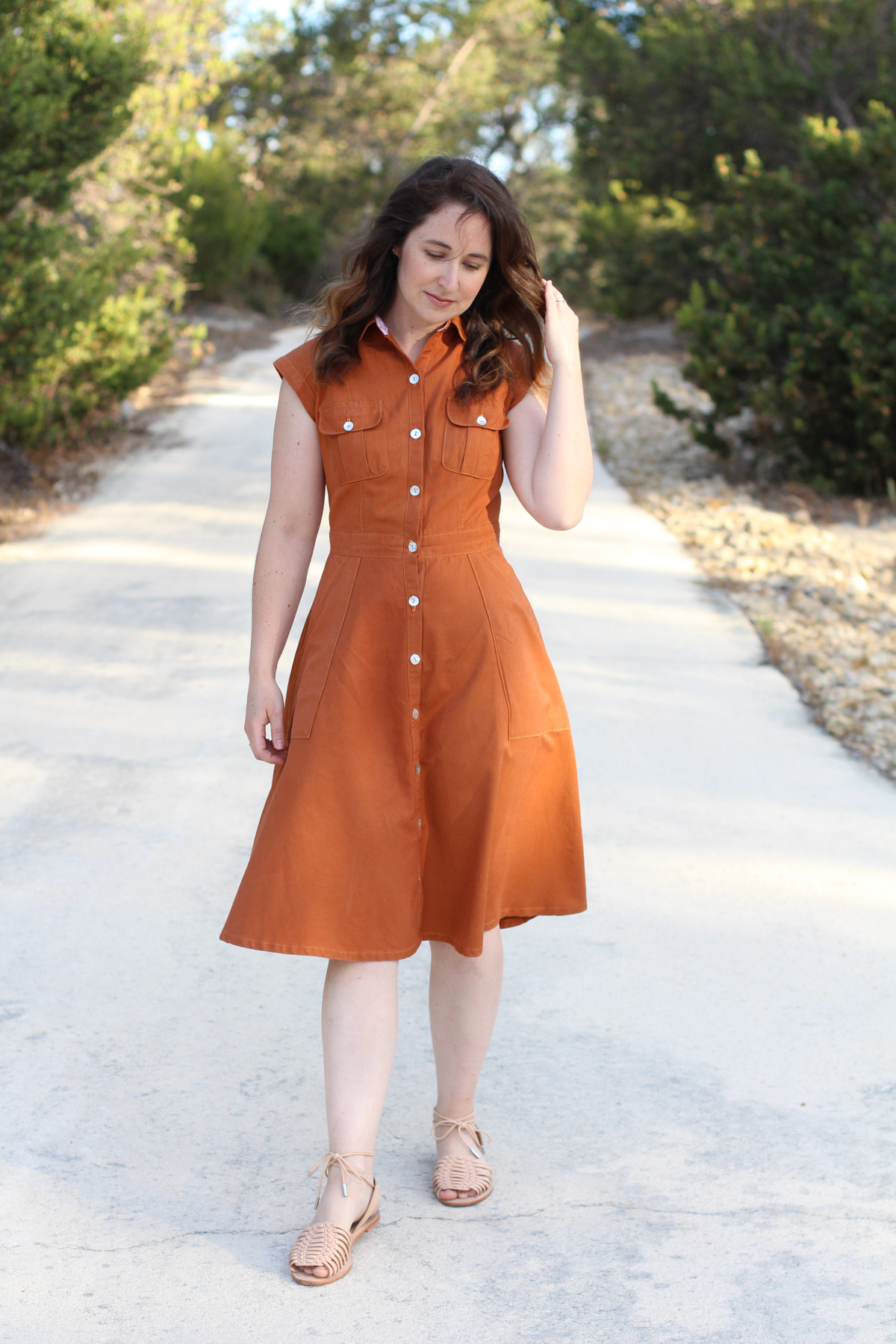 Megan Nielsen Matilda dress in Rust brushed cotton // The buttonhole below the waistband was sliced through and damaged and has been fixed with a narrow zig zag stitch in same colour thread as fabric