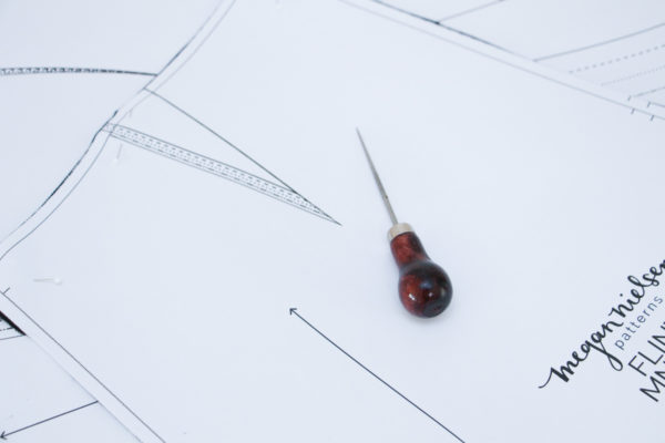 Use an awl to poke a hole in your pattern piece