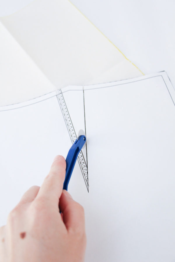Set the carbon paper between the pattern and fabric