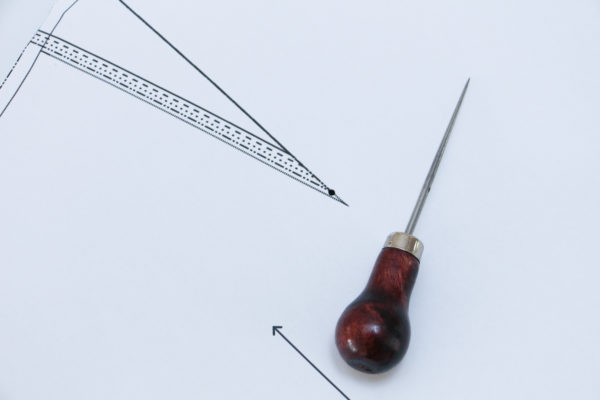 Use an awl or sharp pencil to poke a hole in your pattern