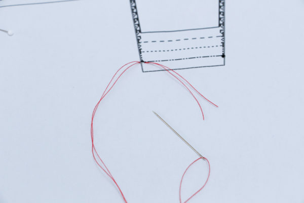 Knot the thread to form the tack