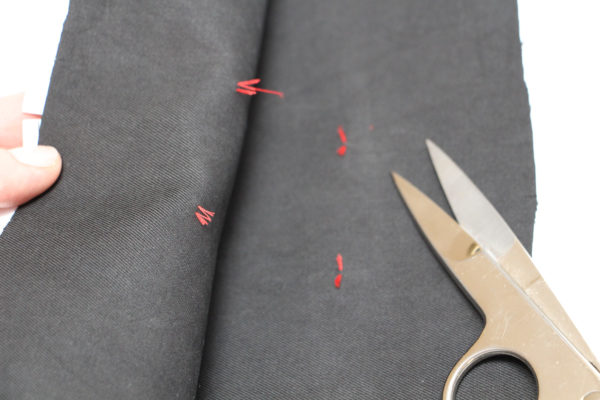 Cut the tacks to keep them in place on both fabric pieces