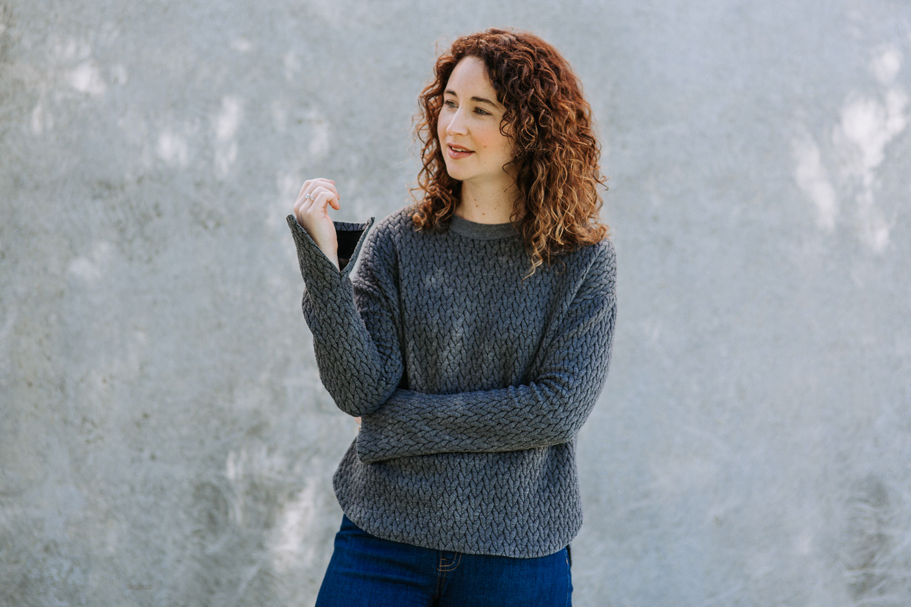 Megan Nielsen Jarrah sweater with curved hem and split sleeves. Made from Herringbone quilted jersey