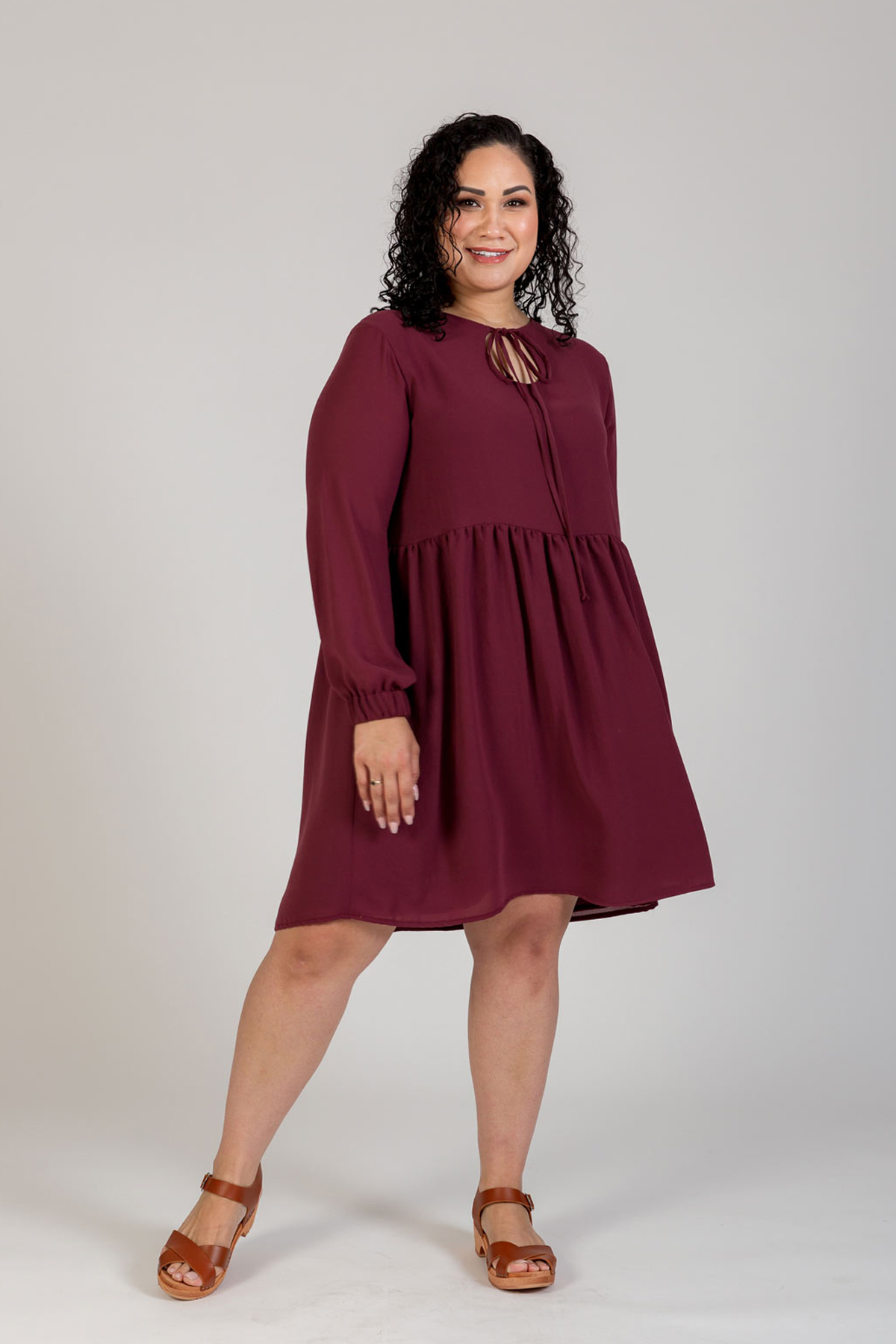 Megan Nielsen Sudley Curve dress View C includes long sleeves with elastic cuffs, a gathered skirt, full lining and lovely long ties. Keyhole can be worn at the back or front of this clever design.