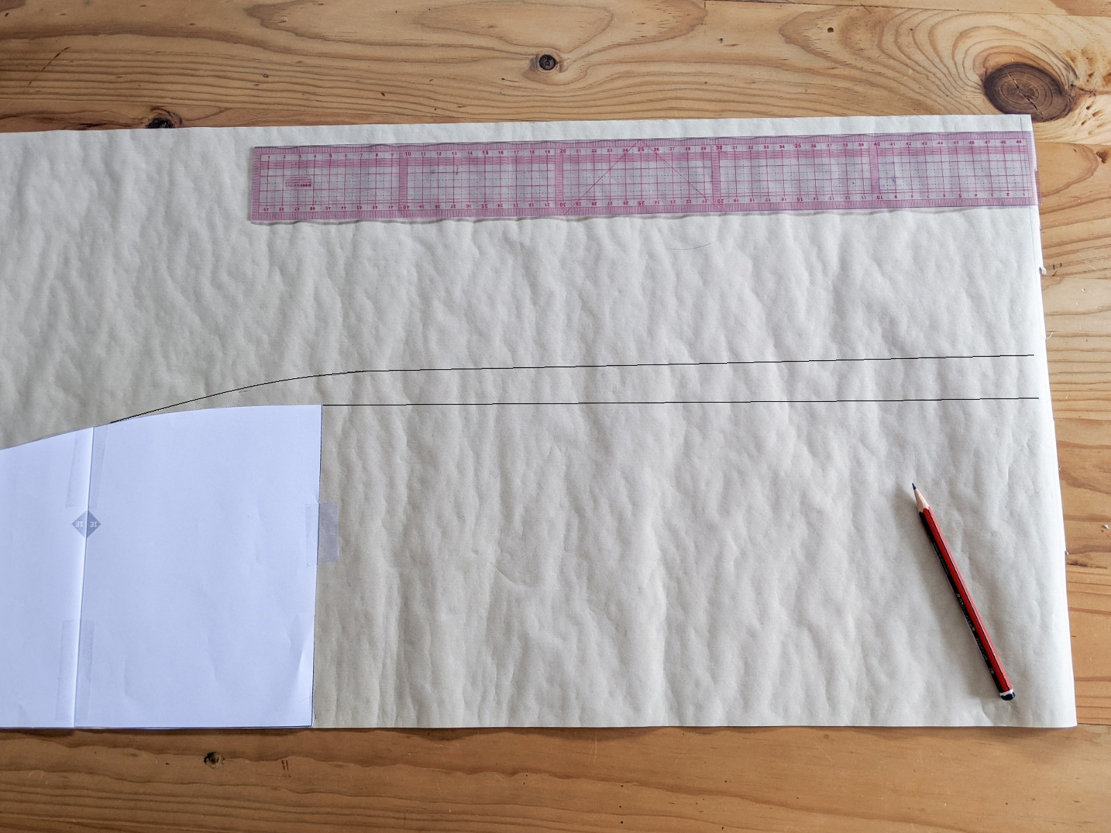 Draw a line, the length of your desired skirt length, perpendicular from the end of the pattern piece.