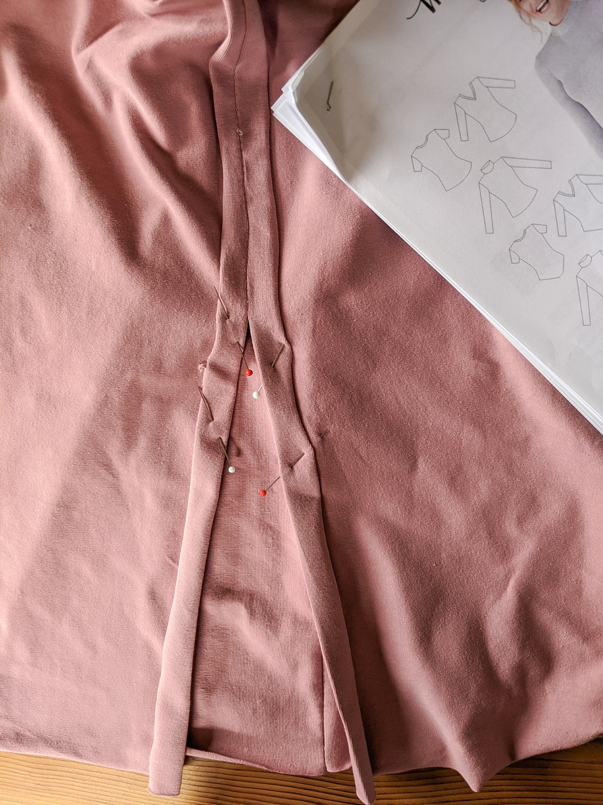 Now flip your dress wrong side out and pin the seam allowances open, at the split.