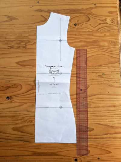Take the front pattern piece and measure from the armpit, down to the hemline.