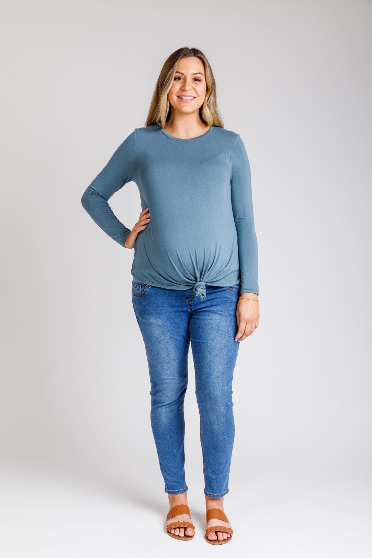 Floreat long tee knotted under baby bump