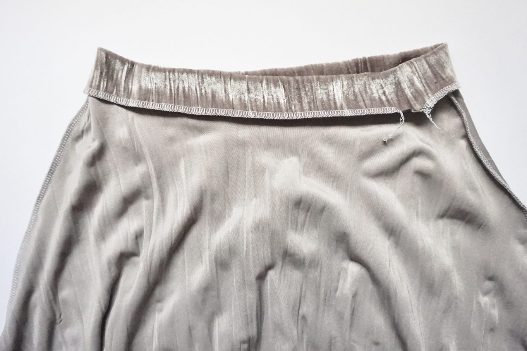 """Sew/serge the waistband to the skirt leaving about a 1-2"""" gap to thread through the elastic."""