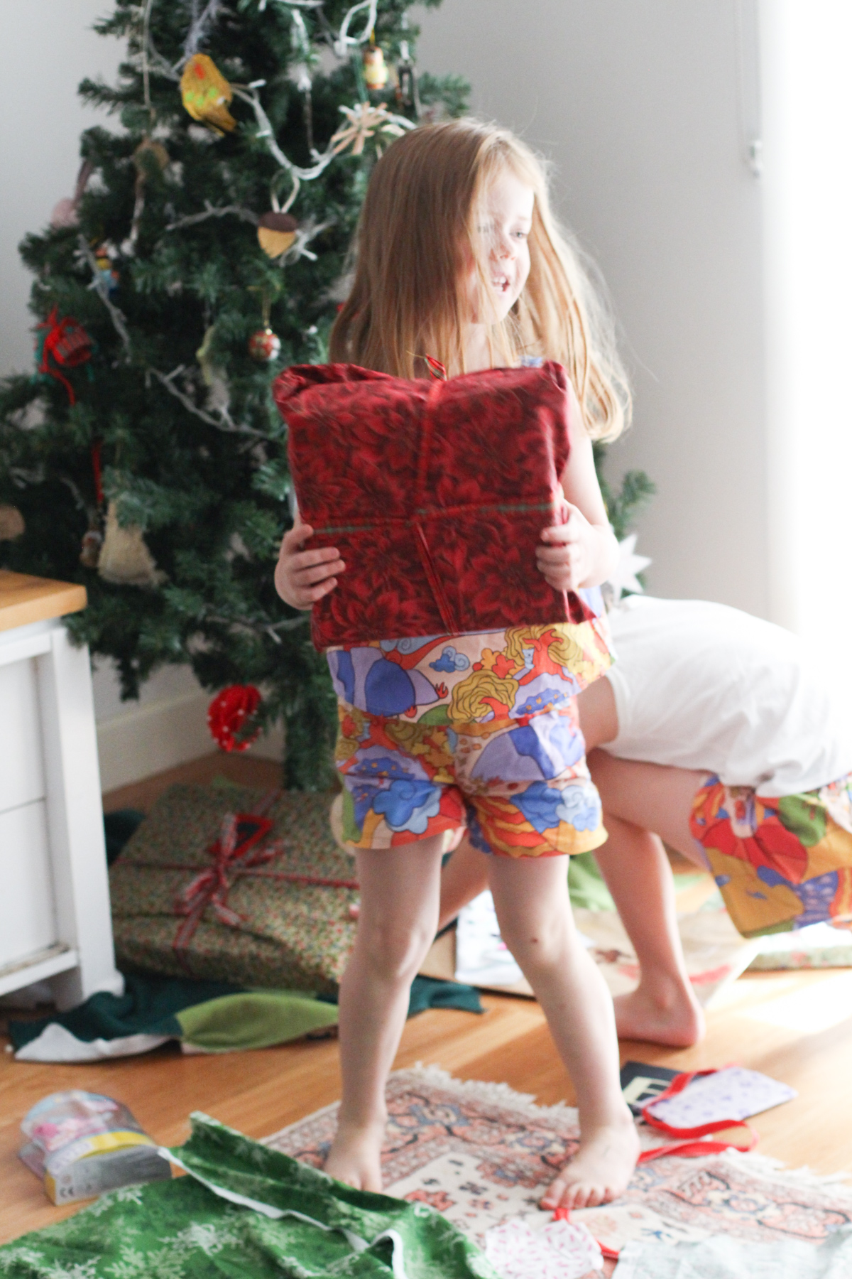 Birdie's 2019 Christmas Pajamas are a Mini Eucalypt tank and shorts both made from Ellie Whittaker Sunburst Country fabric.