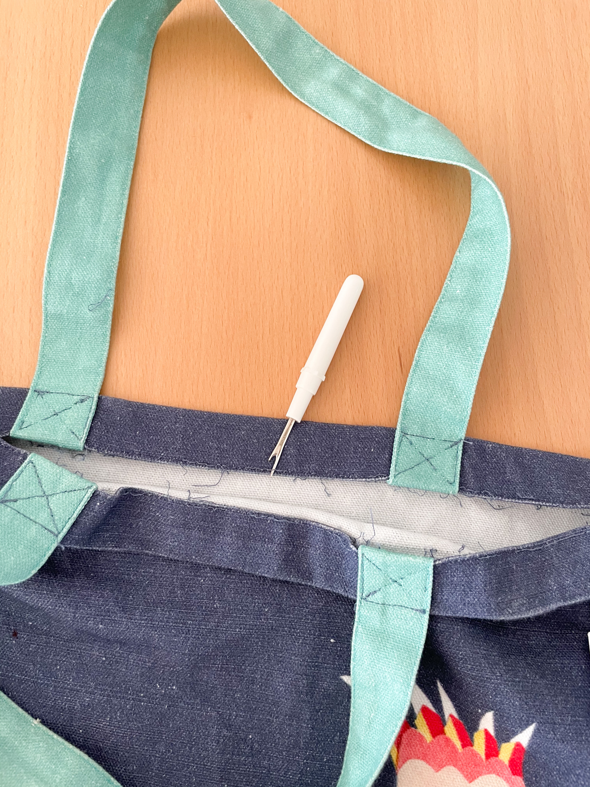 How to Add a Zip to a Tote Bag | Step 1, unpick. Megan Nielsen Patterns Blog