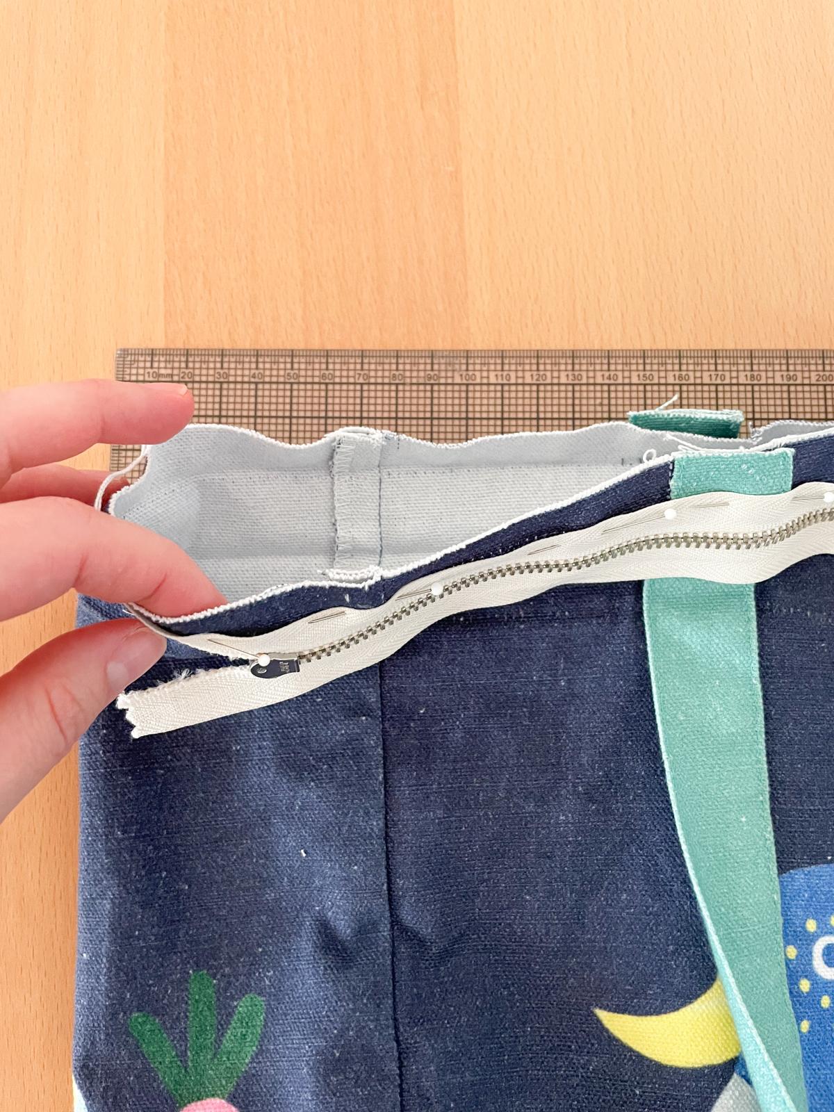 How to Add a Zip to a Tote Bag | Step 3, pin zip to bag right sides together. Megan Nielsen Patterns Blog