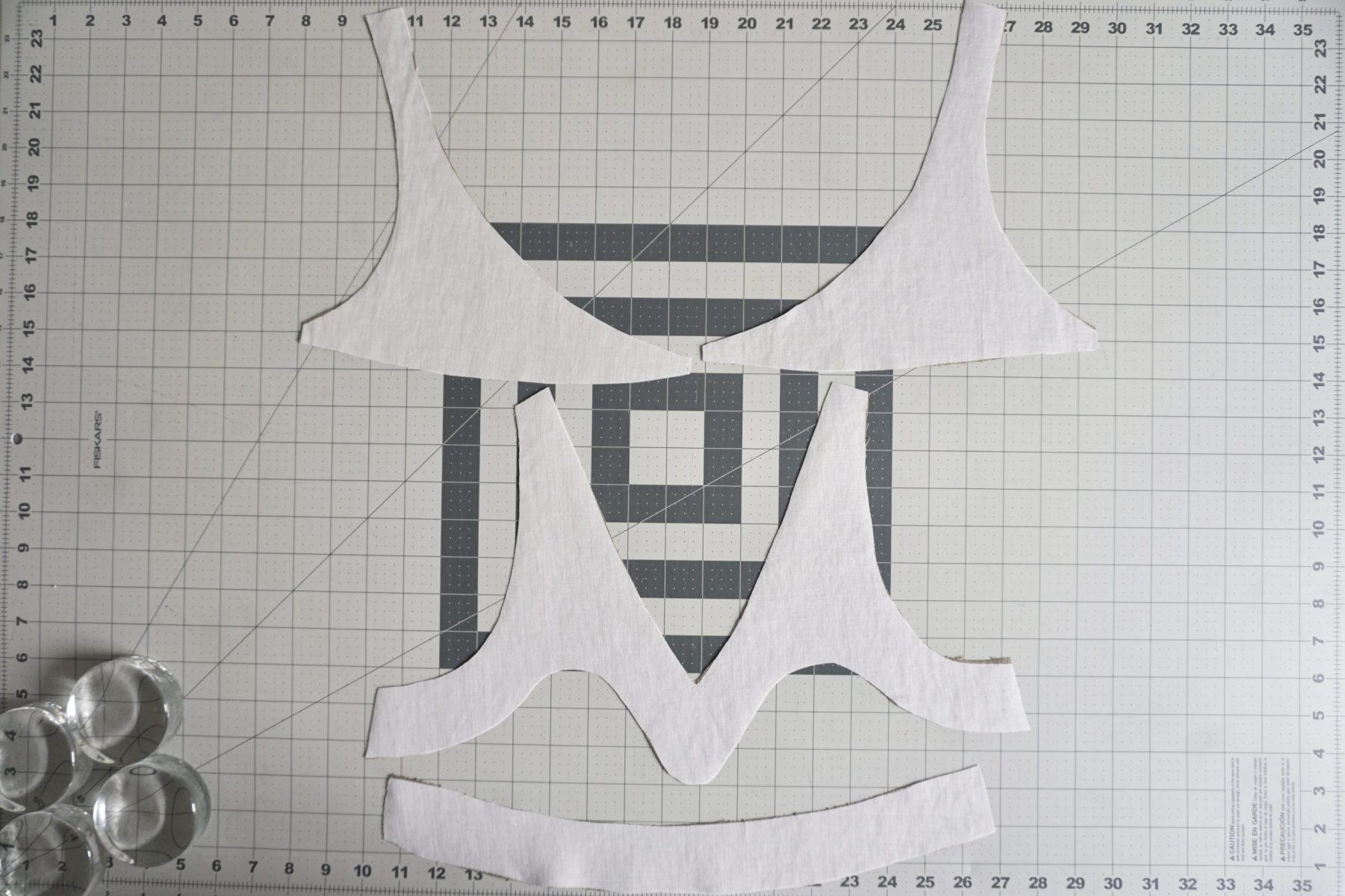 Attach the lightweight fusible interfacing to two of the yoke pieces