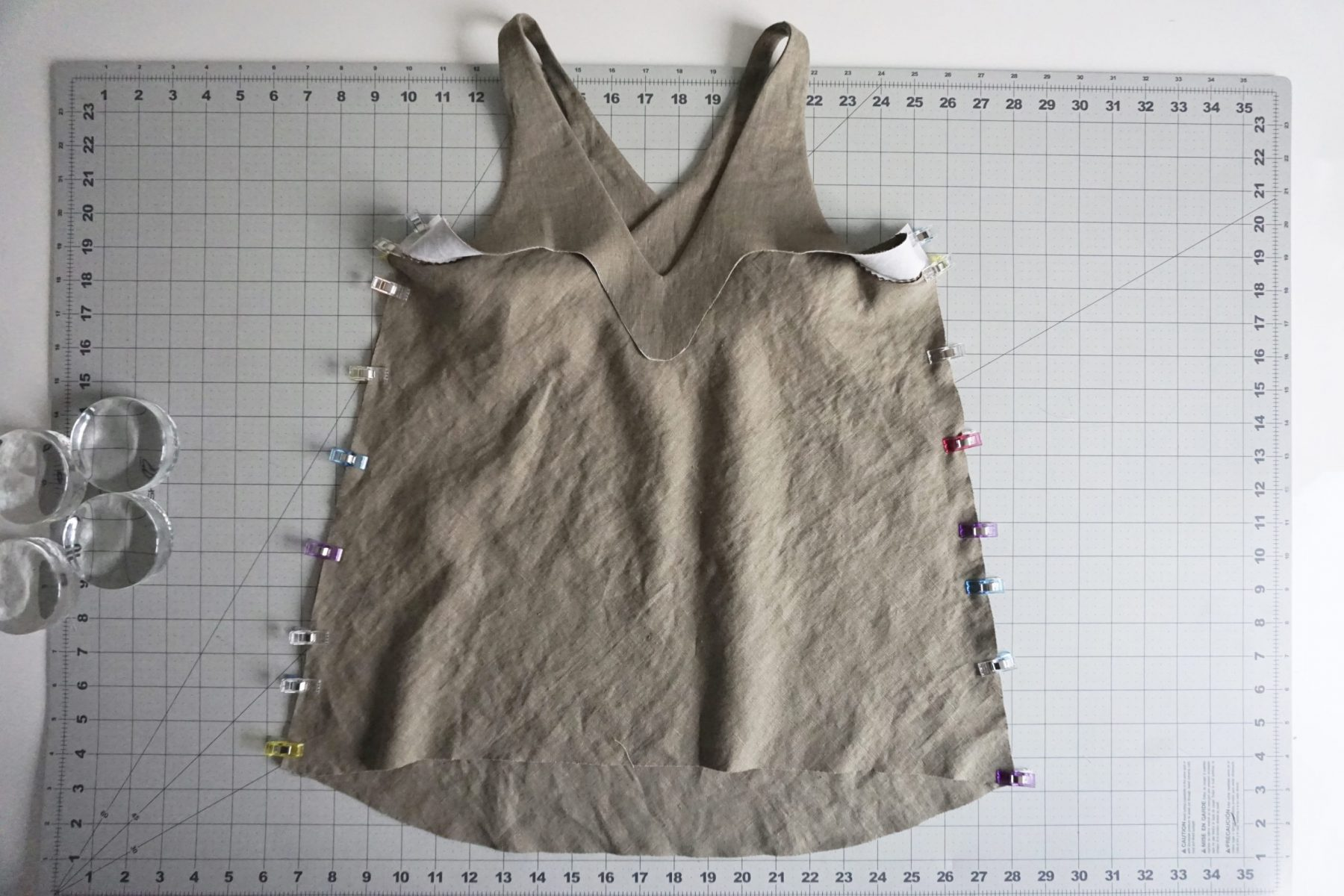 Next, you'll fold the camisole at the shoulder seams