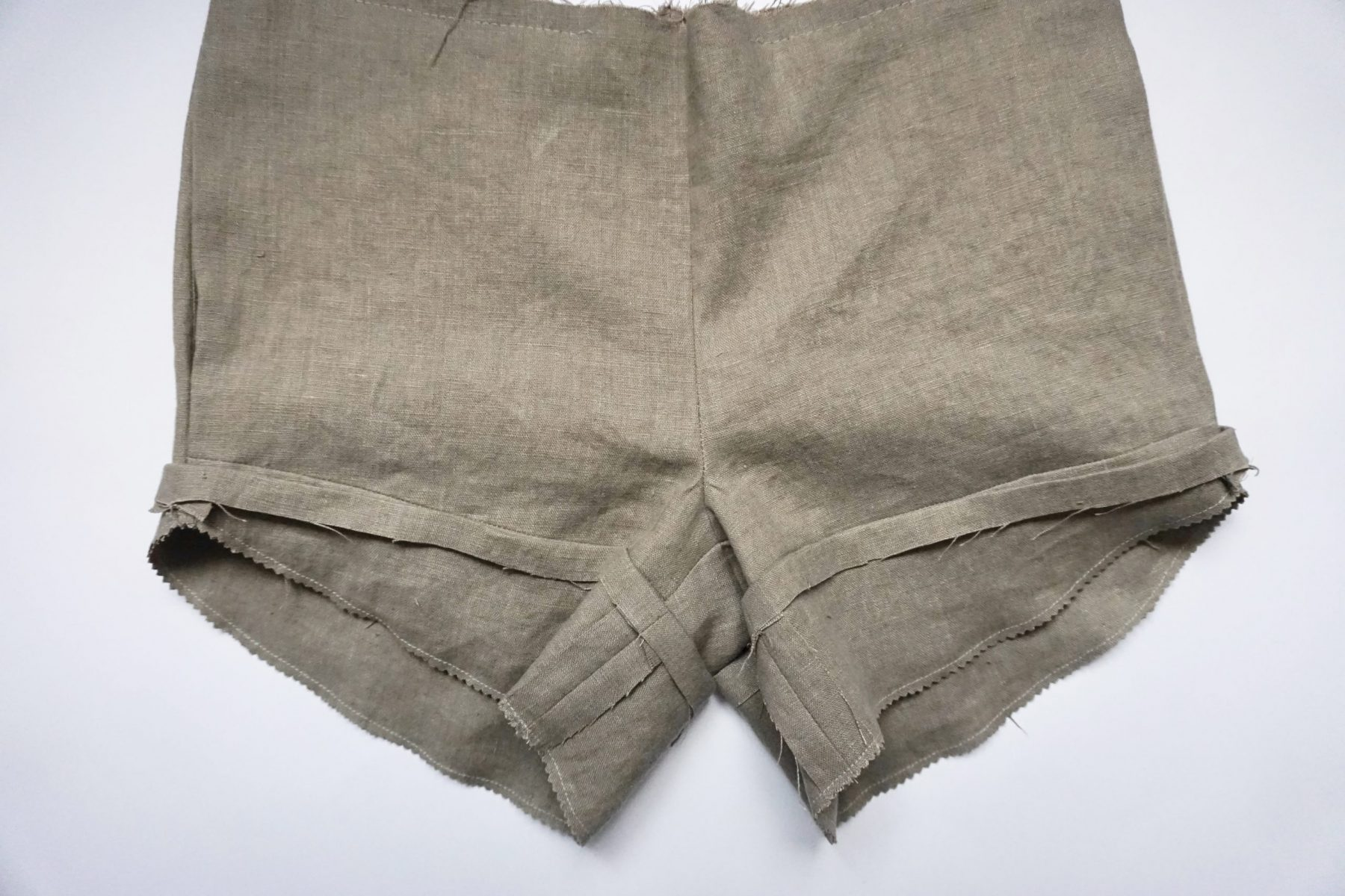 Clip into the corner along the seam line and notch along the hemline.