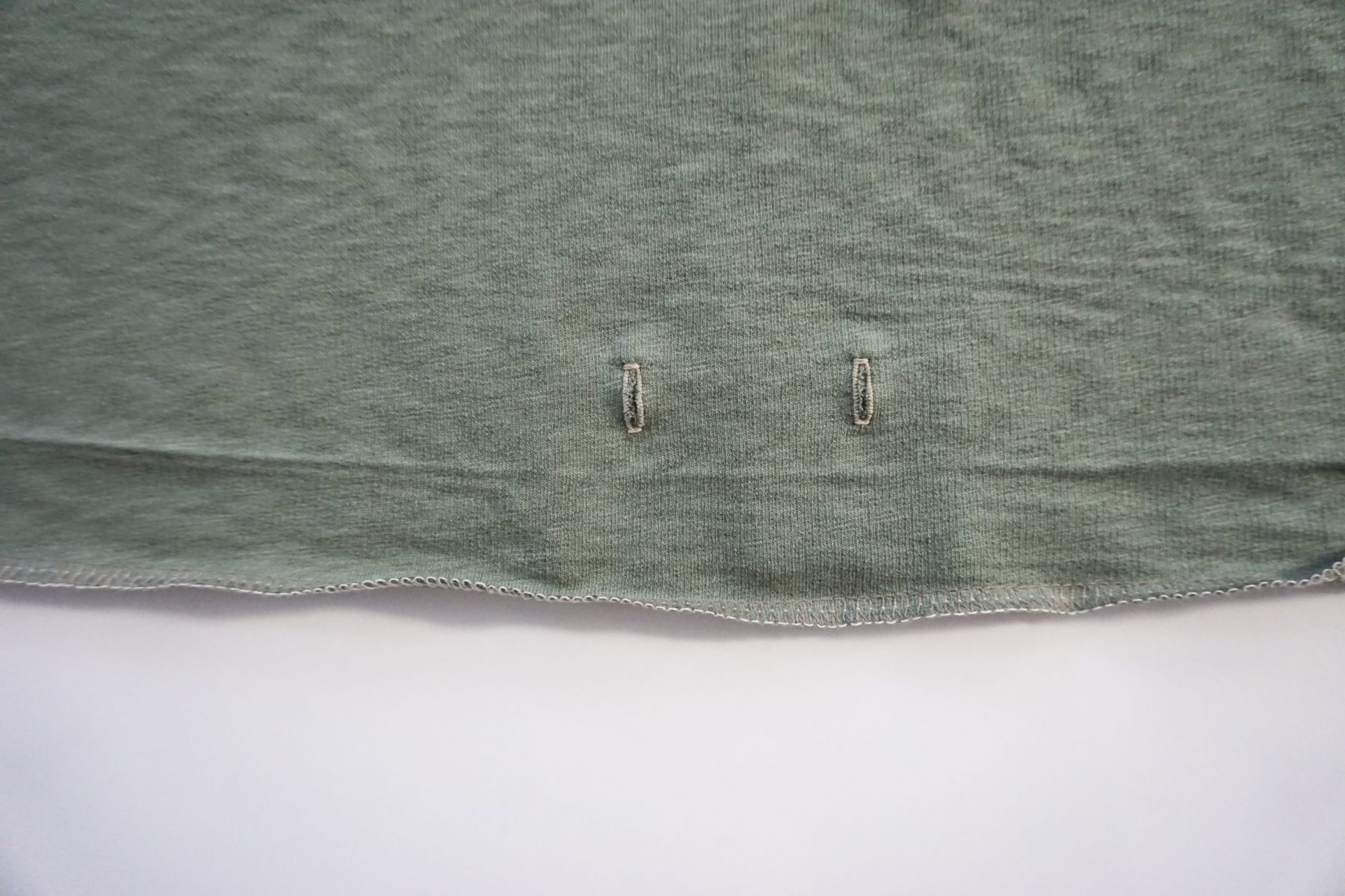 Sew your buttonholes. Open them by placing a pin at one end of the buttonhole and open with a seam ripper.